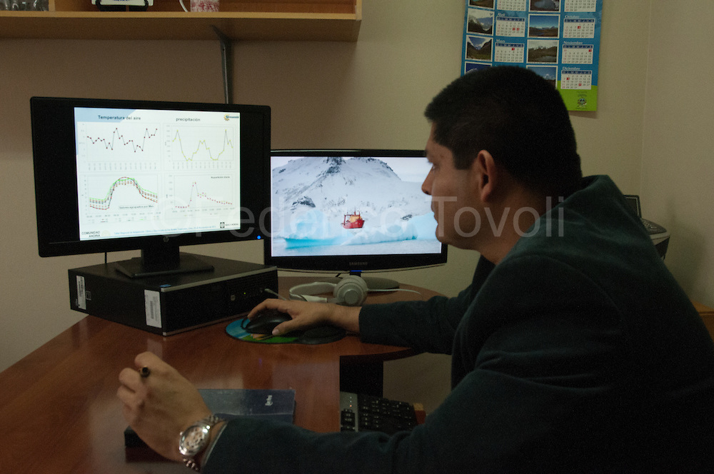 The glaciologist Wilson Suarez into the SENHAMI headq. in Lima  studying the data from the meteorological station of the glacier Huataypallana. Knowing the behavior of glaciers, he says, is to improve the planning of measures to adapt people's lives and work in the fields to irreversible climate change