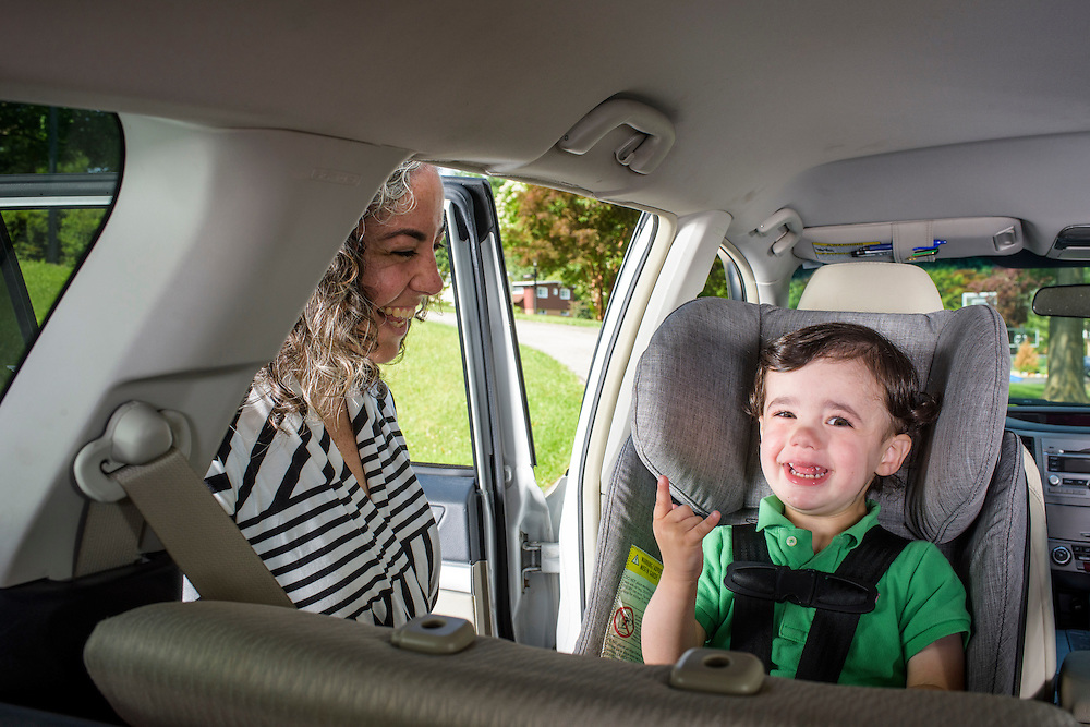Pikesville, Maryland - June 25, 2015:  Car Seat Lady Alisa Baer, 35, from Manhattan, demonstrates the preferred way to seat children in a car, back-facing with her nephew, outside Alisa's sister Abigail Aghion's house in Pikesville, Maryland. <br /> <br /> Eitan sits in a Clek Foonf convertible car seat ($400-$550).<br /> <br /> Alisa Baer, 35, and Emily Levine, 34, both from Manhattan and Alisa's mother Deborah Baer, 67, from Pikesville, Maryland operate The Car Seat Lady blog and car seat installation classes available in New York and Maryland. <br /> <br /> CREDIT: Matt Roth for The New York Times<br /> Assignment ID: 30176354A