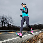 Ironman athlete Amy Avery poses for portraits at Alum Creek on Saturday, January 24, 2015 in Columbus Ohio. Amy was injured while cycling in the 2014 Arizona Ironman competition.  (photo by Leonardo Carrizo)