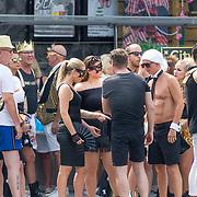 NLD/Amsterdam/20180604 - Gaypride 2018, wac htende deelnemers in zwarte kleding