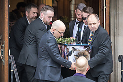 © Licensed to London News Pictures . 30/06/2017 . Stockport , UK . Martyn's coffin is carried away from the Town Hall after the service . The funeral of Martyn Hett at Stockport Town Hall . Martyn Hett was 29 years old when he was one of 22 people killed on 22 May 2017 in a murderous terrorist bombing committed by Salman Abedi, after an Ariana Grande concert at the Manchester Arena . Photo credit : Joel Goodman/LNP