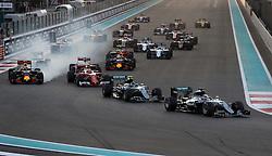 Mercedes' Lewis Hamilton leads into the first corner during the Abu Dhabi Grand Prix at the Yas Marina Circuit, Abu Dhabi.