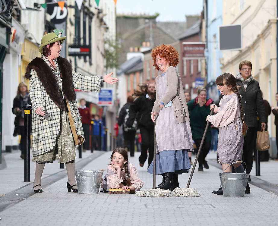 "21/10/2012. Repro Free. Wexford Fringe Festival. Annie - Emma Morris with Orphans' Sara Gore and Alannah Busher-Carley from the stage production 'Annie' took to the streets of  Wexford today (Sunday, October 21) to escape - Adrienne Meyler 'Miss Hannigan' as they get some rehearsal in before they hit the stage this week as part of the 60th annual Wexford Fringe Festival; the 17 day celebration of music, song, dance and the arts runs until November 4, for details on the 260 events see visitwexford.ie – Picture: Patrick Browne<br /> <br />  Sunday, October 21<br />   <br /> 60th Annual Wexford Festival Fringe Kicks Off<br />  <br /> Visitors to Wexford town today (Sunday, October 21) would be forgiven for thinking they had landed in the era of 'Annie' as little 'orphans' took to the streets to promote their performance as part of the 60th Wexford Festival Fringe which opens with a giant fireworks display in Wexford town to announce 17 days of fantastic Fringe Festival events, which run in tandem with the famous Wexford Festival Opera, which is currently celebrating its 61th year.<br />  <br /> Over 260 events will take place across the 17 days of the Fringe Festival with many taking place free of charge; organiser's say the festival will attract approximately 18,000 visitors to the town.<br />  <br /> Commenting on the upcoming festival, Wexford Festival Fringe Coordinator, Tracey Morgan said, ""This festival delivers the very cultural experiences and has become a vital showcase for Irish arts nationally and internationally, and with over 250 eclectic events all squeezed into a town with stunning scenery, top class accommodation and mouth-watering cuisine, this is a feast of artistic entertainment not to be missed.<br />  <br /> The festival takes place at a time of year which is typically seen as the close of the peak tourism season so it offers a huge economic boost to the town and environs with an expected 18,000 visitors set to come to Wexford to join the celebrations.""<br />  <br /> The opening ceremony fireworks display takes place a"