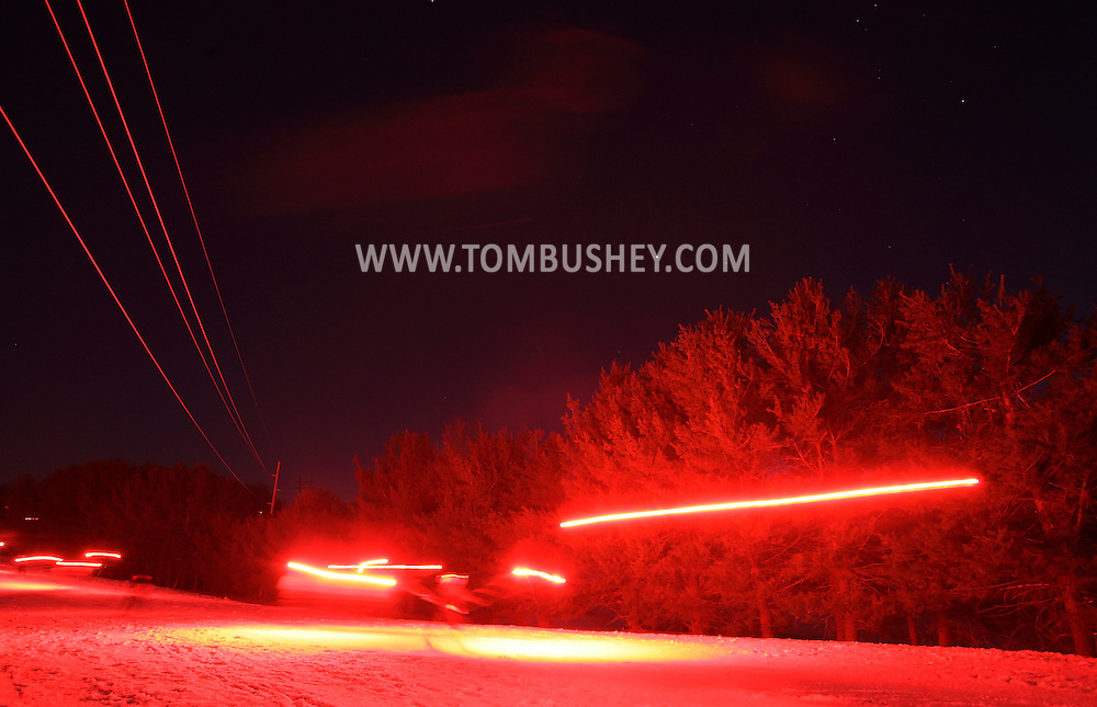Warwick, New York - Skiers carry flares down the mountain as Mount Peter Ski and Ride celebrates its 75th anniversary  March 19, 2011. The family-run business is the oldest operation ski area in New York State.