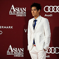 HONG KONG - MARCH 22:  Taiwan's actor Eddie Peng poses at the red carpet for the 4th Asian Film Awards ceremony at the Convention and Exhibition Centre on March 22, 2010 in Hong Kong.  Photo by Victor Fraile / studioEAST