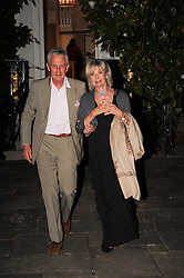 LADY RAYNE and ROBERT LACEY leaving a summer party hosted by Lady Annabel Goldsmith at her home Ormeley Lodge, Ham Gate, Richmond on 13th July 2010.