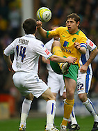 Norwich - Saturday March 27th, 2010:  Jonathan Howson of Leeds and Grant Holt of Norwich in action during the Coca Cola League One match at Carrow Road, Norwich. (Pic by Paul Chesterton/Focus Images)