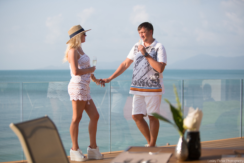 Couple relaxing and drinking on the upper terrace at Sea and Sky beach front restaurant located on Ban Tai beach, Koh Samui, Thailand