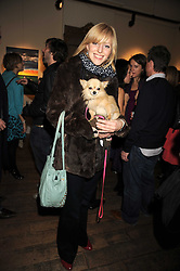 GLORIA FRAMPTON and her dog Chuck at an exhibition of Sarah-Jane Boler's paintings entitled 'Life on The Farm' held at The Troubadour, 265 Old Brompton Road, London on 27th November 2008.