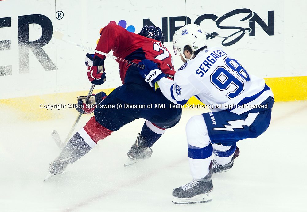 WASHINGTON, DC - MAY 21: Tampa Bay Lightning defenseman Mikhail Sergachev (98) checks into Washington Capitals right wing Devante Smith-Pelly (25) during game 6 of the NHL Eastern Conference  Finals between the Washington Capitals and the Tampa Bay Lightning, on May 21, 2018, at Capital One Arena, in Washington D.C. The Caps defeated the Lightning 3-0<br /> (Photo by Tony Quinn/Icon Sportswire)