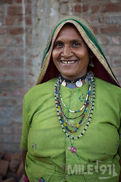 A portrait of Sheela, a farmer in Sendhwa, India.<br /> <br /> Sheela is married to Manga.