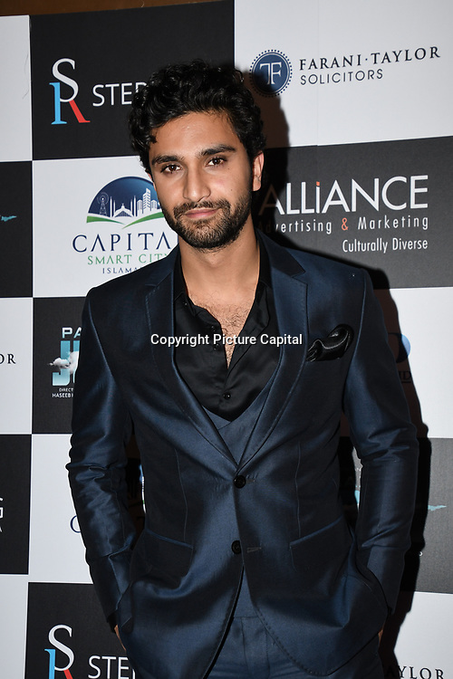 "Ahad Raza Mir attend Photocall in London Premiere of ""Parwaaz Hai Junoon"" (Soaring Passion) as featured on SKY, ITV at The May Fair Hotel, Stratton Street, London, UK. 22 August 2018."