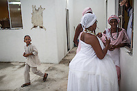 RIO DE JANEIRO, BRAZIL - JANUARY 24: Practitioners prepare for rituals in a candomble ceremony, in Rio de Janeiro, Brazil, on Saturday, Jan. 23, 2015. Brazil's Afro-Brazilian religions which in recent years have come under increasing threats and prejudice, particularly from the growing number of evangelical churches. Candombl&eacute; originated in Salvador, Bahia at the beginning of the 19th century when enslaved Africans brought their beliefs with them. Umbanda and candombl&eacute; are Afro-Brazilian religions practiced in mostly Brazil. <br /> (Lianne Milton for the Washington Post)
