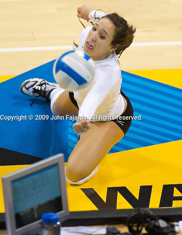Libby Fontanilla keeps the ball live for play in the Big West Conference game against Cal Poly at the Walter Pyramid, Long Beach CA, Saturday Oct. 3, 2009.