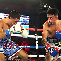 "KISSIMMEE, FL - MAY 25: Adam Lopez punches Jean Carlos ""Chapito"" Rivera during their Jr. NABF Featherweight Title fight at Osceola Heritage Park on May 25, 2019 in Kissimmee, Florida. (Photo by Alex Menendez/Getty Images) *** Local Caption *** Jean Carlos Rivera; Adam Lopez"