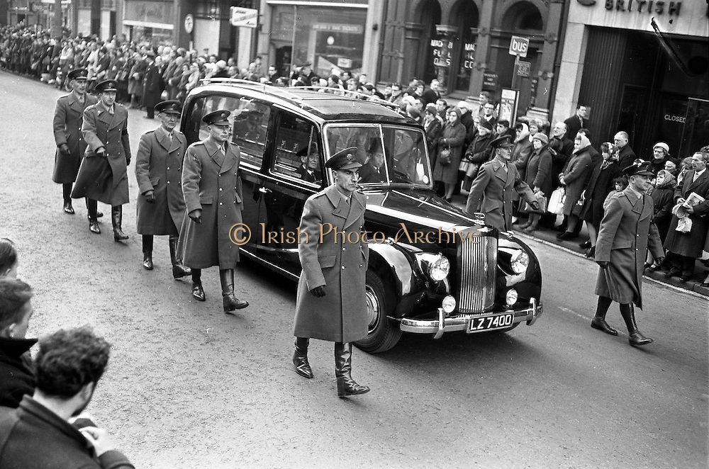 The scene in O'Connell Street as thousands of people lined the street for the funeral of Cardinal D'Alton. 600 troops of the army and the No. 1 Army Band head the cortege. The cardinal was buried in St Patrick's Cathedral, Armagh. .02.02.1963