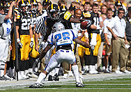 September 4 2010: Iowa Hawkeyes wide receiver Marvin McNutt (7) tries to avoid Eastern Illinois Panthers cornerback Rashad Haynes (26) during the first quarter of the NCAA football game between the Eastern Illinois Panthers and the Iowa Hawkeyes at Kinnick Stadium in Iowa City, Iowa on Saturday September 4, 2010. Iowa defeated Eastern Illinois 37-7.