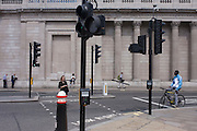 Pedestrians make their way across Threadneedle Street, beneath the tall pillars and columns of the Bank of England, on 4th July, in London, United Kingdom. (Photo by Richard Baker / In Pictures via Getty Images)