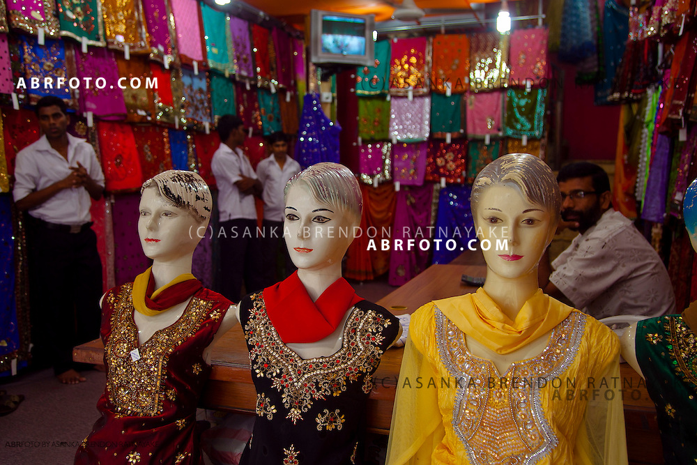 Dressed up mannequins in a colourful sari boutique in the main shopping precinct of Pettah.