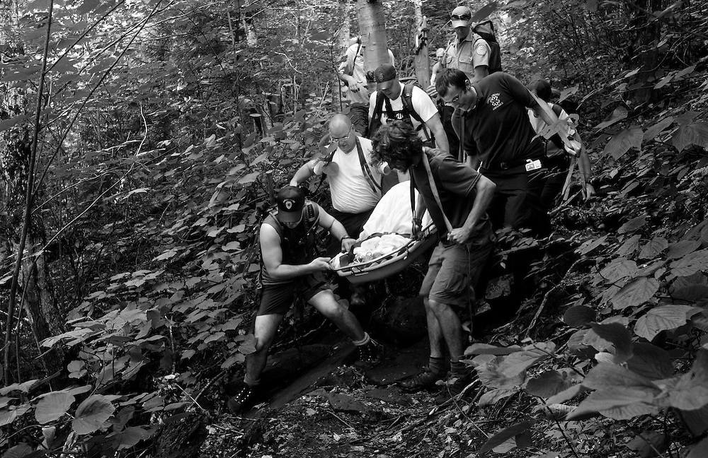 While descending from the summit of Mount Cube with her family Thursday, July 5, 2012, Christina Brownell slipped and fell injuring her back on a rock. A team of more than 20 from Upper Valley Ambulance, NH Fish and Game, Upper Valley Wilderness Response Team and a handful of Appalachian Trail hikers worked to carry her down two miles of trail to a waiting ambulance.<br /> Valley News - James M. Patterson<br /> jpatterson@vnews.com<br /> photo@vnews.com