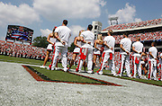 The Georgia cheerleaders pause during the national anthem before the game between the University of Georgia Bulldogs and University of Alabama-Birmingham (UAB) Blazers at Sanford Stadium in Athens, GA on September 16, 2006.  The Bulldogs beat the Blazers 34-0.