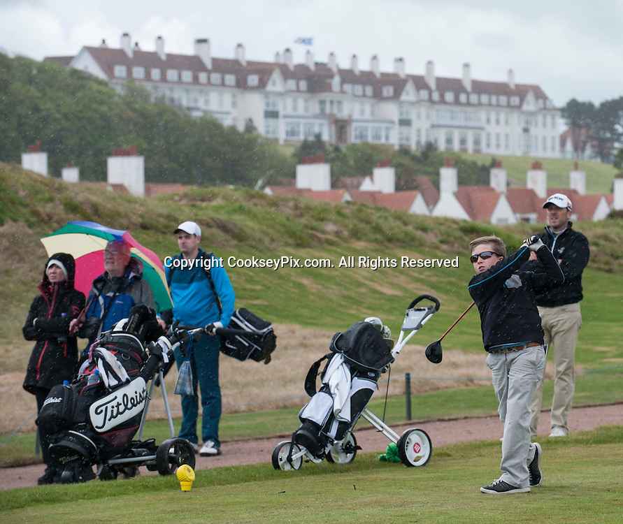 Picture by Christian Cooksey/CookseyPix.com. Free First Use. Fathers Day Golf at Trump Turnberry with The Herald.<br /> <br /> Pictured teeing off on the  1st hole of the Kintyre course with the famous Turnberry Hotel behind is Sam Allister from Belfast