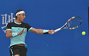 0910.2015. Beijing, China. Spains Rafael Nadal returns a shot during the mens singles quarterfinal of the China Open tennis tournament against Jack Sock of the United States in Beijing, China, Oct. 9, 2015. Nadal won 2-1 and advanced to the semifinal.