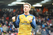 Arsenal defender Nacho Monreal celebrates in front of the travelling fans at full time in the Barclays Premier League match between Bournemouth and Arsenal at the Goldsands Stadium, Bournemouth, England on 7 February 2016. Photo by Graham Hunt.