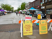 23 MAY 2020 - AMES, IOWA: A sign welcoming shoppers to the Farmers' Market in downtown Ames. The Ames Main Street Farmers' Market reopened Saturday after nearly a month of only online sales because of Iowa's bans on large gatherings caused by the COVID-19 pandemic. Only about 15 venders set up stalls Saturday and attendance was significantly lower than normal. All of the venders wore face masks and many, but not all, of the shoppers wore face masks. Farmers' markets are popular community gatherings in Iowa, but they've been on hiatus since the Coronavirus (SARS-CoV-2) pandemic. At this time, Iowa farmers' markets are not allowed to have entertainment or sell non-food or non-agricultural goods.         PHOTO BY JACK KURTZ