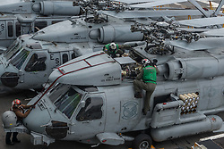 "WATERS SOUTH OF JAPAN (May 18, 2017) Sailors assigned to the ""Saberhawks"" of Helicopter Maritime Strike Squadron (HSM) 77 inspect an MH-60R Sea Hawk helicopter on the flight deck of the aircraft carrier USS Ronald Reagan (CVN 76). The ship is the flagship of Carrier Strike Group 5, providing a combat-ready force that protects and defends the collective maritime interests of its allies and partners in the Indo-Asia-Pacific region. (U.S. Navy photo by Mass Communication Specialist 2nd Class Jamal McNeill/Released)170518-N-PF593-029 <br /> Join the conversation:<br /> http://www.navy.mil/viewGallery.asp<br /> http://www.facebook.com/USNavy<br /> http://www.twitter.com/USNavy<br /> http://navylive.dodlive.mil<br /> http://pinterest.com<br /> https://plus.google.com"
