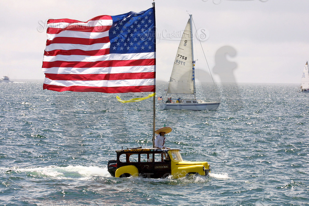 Apr 26, 2002; Newport Beach, California, USA; DENNIS ST.ONAGE on 'Da-Woody', inherited from Sea World in 1965, checks out the 55th annual 125 mile Newport to Ensenada Yacht Race.<br />