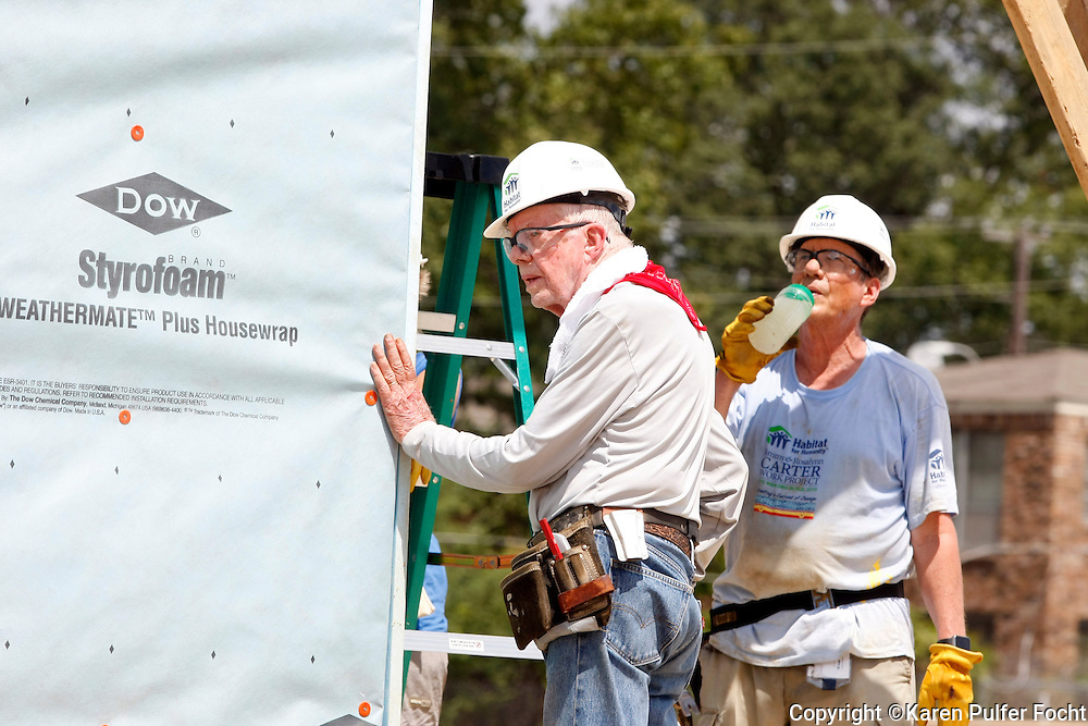 """JIMMY CARTER builds homes for the needy in Memphis on Tuesday for the 33rd annual Jimmy & Rosalynn Carter Work Project. They're building 19 homes for Habitat for Humanity of Greater Memphis. The Former President Jimmy Carter said Monday that he put on """"a false, optimistic face"""" and that """"I just thought I had a few weeks to live.""""  He announced on Aug. 14, 2015, that he'd had a mass removed from his liver and that he'd been diagnosed with cancer which emerged that melanoma spots had reached his brain. He was onsite with hundreds of volunteers building new homes and a new neighborhood in needy North Memphis."""