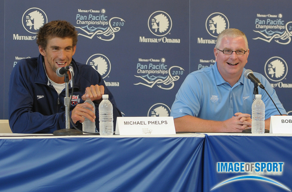 Aug 16, 2010; Irvine, CA, USA; Michael Phelps (left) and coach Bob Bowman at the 2010 Pan Pacific swimming championships press conference at the William at Woollett Jr. Aquatics Center. Photo by Image of Sport