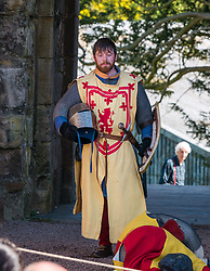 Medieval Day. Dirleton Castle, East Lothian, Scotland, United Kingdom, 11 May 2019. Pictured:  Historic Environment Scotland family fun day historical re-enactment of Medieval battles by Saltire History Society; 1298 English seizing the castle by Bishop Bek from John de Vaux and Robert the Bruce taking it from Aymer de Valence in early 1300s<br /> <br /> Sally Anderson | EdinburghElitemedia.co.uk