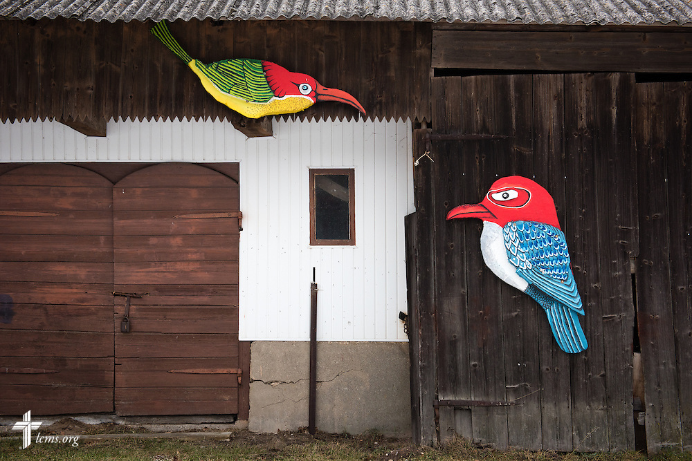 Painted birds adorn a building at the  Diaconia daycare center under the Evangelical Lutheran Church in Lithuania on Friday, Feb. 6, 2015, in rural Skirsnemune, Lithuania. LCMS Communications/Erik M. Lunsford