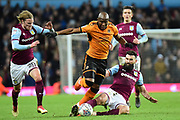 Aston Villa midfielder Mile Jedinak (15) slides in to tackle Wolverhampton Wanderers striker (on loan from Bournemouth) Benik Afobe (19) during the EFL Sky Bet Championship match between Aston Villa and Wolverhampton Wanderers at Villa Park, Birmingham, England on 10 March 2018. Picture by Dennis Goodwin.