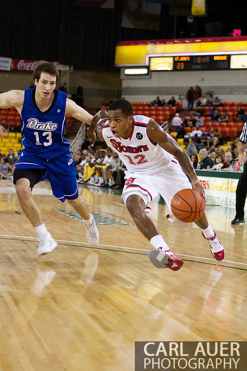 November 26th, 2010:  Anchorage, Alaska - St. John's senior guard Dwight Hardy (12) drives in the Red Storm's semi final game of the Great Alaska Shootout against the Drake Bulldogs.  The Red Storm defense held Drake to a tournament low score as St. Johns advanced to the final game 82-39.
