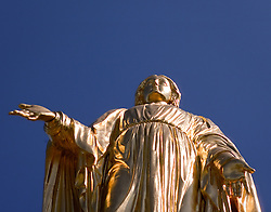 Statue of the Blessed Virgin Mary atop the Golden Dome, University of Notre Dame..Photo by Matt Cashore..