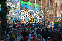 People gather at the Olympic Rings on a sunny day during the 2010 Olympic Winter Games in Whistler, BC Canada.