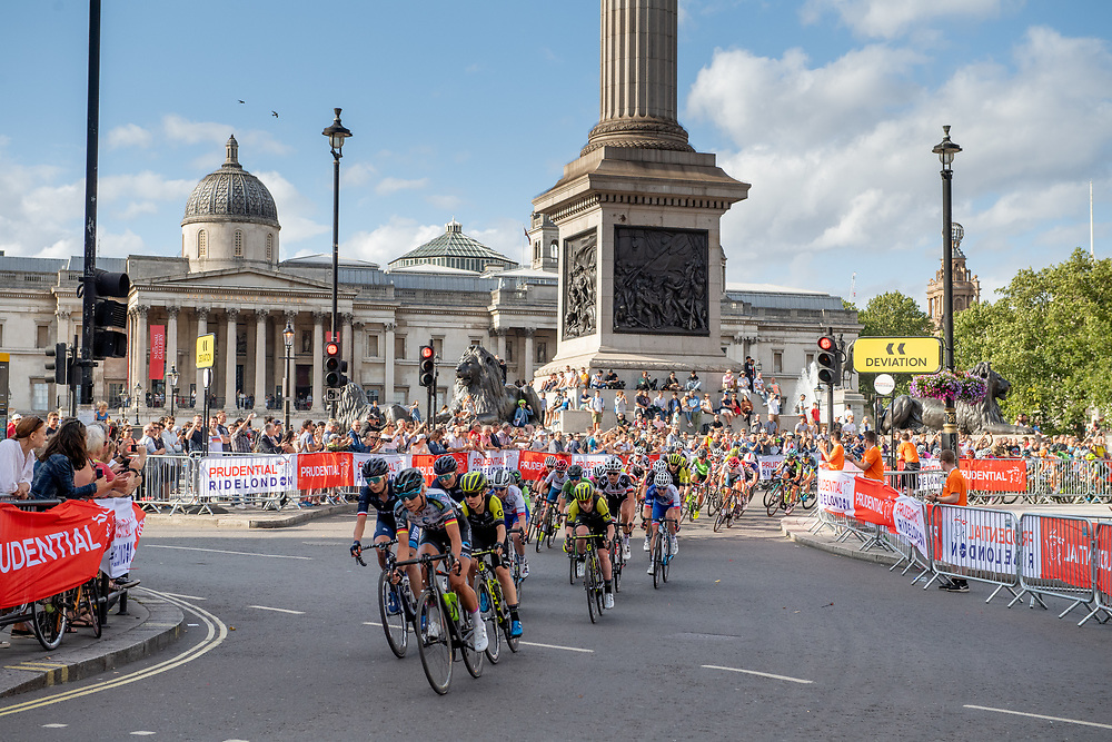 The riders race around Trafalgar Square. Prudential RideLondon Classique. Saturday 28th July 2018<br /> <br /> Photo: Thomas Lovelock for Prudential RideLondon<br /> <br /> Prudential RideLondon is the world's greatest festival of cycling, involving 100,000+ cyclists - from Olympic champions to a free family fun ride - riding in events over closed roads in London and Surrey over the weekend of 28th and 29th July 2018<br /> <br /> See www.PrudentialRideLondon.co.uk for more.<br /> <br /> For further information: media@londonmarathonevents.co.uk