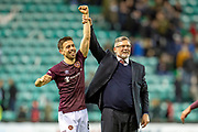 Craig Levein, manager of Heart of Midlothian and goalscorer Olly Lee (#8) of Heart of Midlothian salutes the Hearts fans after winning the Ladbrokes Scottish Premiership match between Hibernian FC and Heart of Midlothian FC at Easter Road Stadium, Edinburgh, Scotland on 29 December 2018.