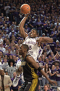 Kansas State forward David Hoskins (15) drives to the basket over Missouri's Jimmy McKinney (1) during the second half of K-State's 79-64 win over the Tigers at Bramlage Coliseum in Manhattan, Kansas, January 21, 2006.