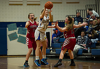 Gilford's Olivia Trindade makes a pass with pressure from Belmont defenders Elaine Hoey and Jordan Sargent during NHIAA division III basketball on Friday evening.  (Karen Bobotas/for the Laconia Daily Sun)