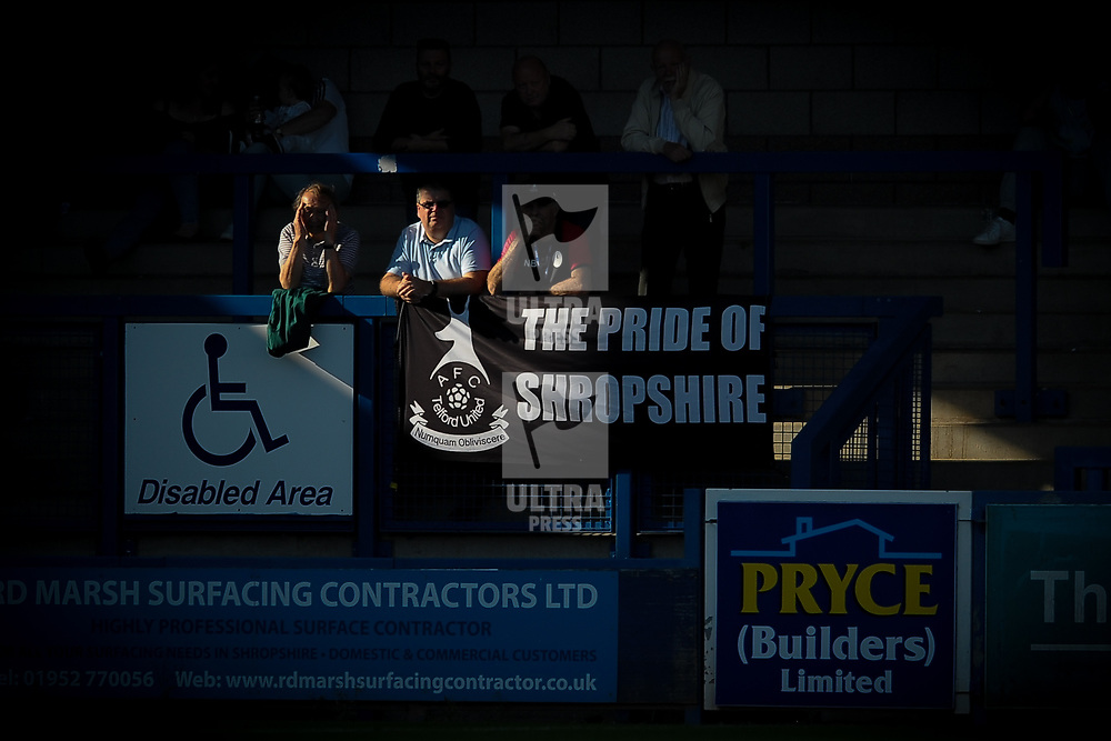 TELFORD COPYRIGHT MIKE SHERIDAN AFC Telford fans watch on during the FA Cup fixture between AFC Telford United and Nantwich Town on Saturday, September 21, 2019.<br /> <br /> Picture credit: Mike Sheridan<br /> <br /> MS201920-020