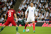 England defender, Chris Smalling (06) looking up with the ball during the Friendly International match between England and Portugal at Wembley Stadium, London, England on 2 June 2016. Photo by Matthew Redman.