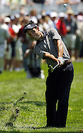 Edoardo Molinari of Italy chips from the rough on the first hole during the first day of the US Open Golf Championship at Winged Foot Golf Club in Mamaroneck, New York Thursday, 15 June 2006.