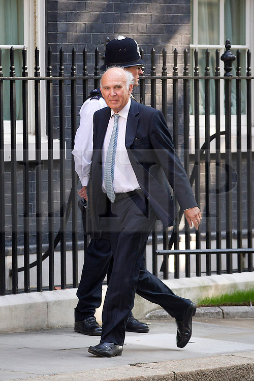 """© Licensed to London News Pictures. 29/08/2013. London, UK. Business Secretary Vince Cable arrives for a meeting of the British cabinet on Downing Street in London today (29/08/2013) as a recalled British Parliament prepares to debate the possibility of """"direct"""" military action over recent reports an alleged chemical weapons attack in Syria. Photo credit: Matt Cetti-Roberts/LNP"""