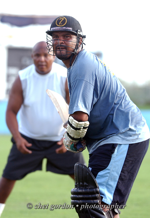 St. George's Cricket Club batsman Jason Anderson (right) awaits a ball as assistant coach Wendell Smith (rear) watches during practice at the St. George's Cricket Club in St. George's, Bermuda on Tuesday, July 26, 2011. St. George's will host Somerset in the annual two-day cricket tournament known as Cup Match beginning Thursday. Cup Match was introduced after the abolition of slavery in Bermuda. Men from Somerset and St. George's met in a friendly rivalry and held celebrations of Emancipation by holding annual picnics to mark the anniversary of the abolition of slavery. One of the highlights from the picnics was a friendly cricket match played between lodges from the east and west ends of the island. In 1901, during a cricket match between two major Friendly Societies, an agreement was made to play for an annual trophy. Members of the Friendly Societies and Lodges raised funds and in 1902 a silver cup that was played for annually was introduced.