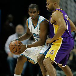 12 November 2008: New Orleans Hornets guard Chris Paul (3) is guarded by Los Angeles Lakers guard Derek Fisher (2) during a NBA regular season game between the Los Angeles Lakers and the New Orleans Hornets at at the New Orleans Arena in New Orleans, LA..