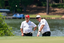 Former Ohio State head football coach Urban Myer chips a shot while Former Ohio State running back Jeff Logan looks on during the 2019 Chick-fil-A Peach Bowl Challenge at the Ritz Carlton Reynolds, Lake Oconee, on Tuesday, April 30, 2019, in Greensboro, GA. (Paul Abell via Abell Images for Chick-fil-A Peach Bowl Challenge)